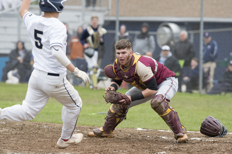 05/14/19  Wesley Bunnell   Staff  Newington baseball defeated New Britain 4-3 in a walk off on Tuesday afternoon at Newington High School. Michael Gajda (15) tags out the Newington runner Gunnar Johnson (5).