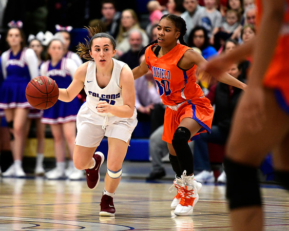 3/5/2019 Mike Orazzi | Staff Bloomfield's Kennedy Carter (30) and St. Paul Catholic High School''s Catherine Ciampi (21) during the Class S Quarterfinals Girls Basketball Game Tuesday night in Bristol.
