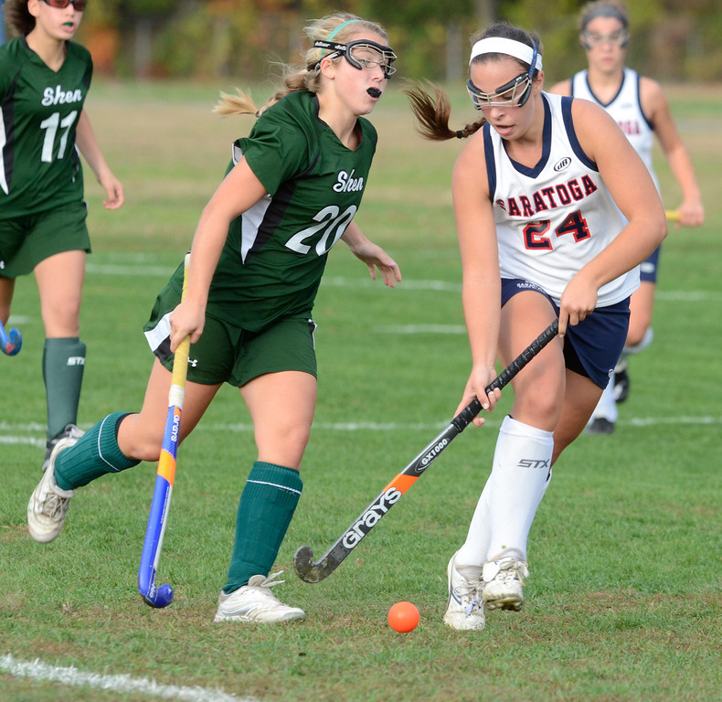 . Saratoga\'s Anne Mahoney dribbles the ball ahead of Shen\'s Claire Virkler during Wednesday\'s varsity field hockey game at Saratoga. Ed Burke -  The Saratogian 10/16/13