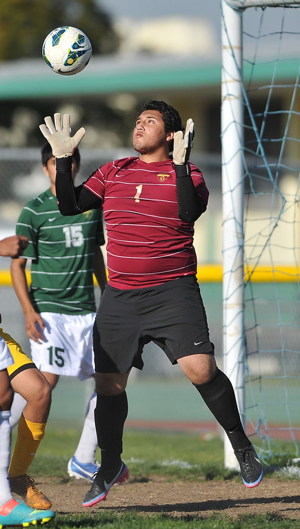 . 2/13/13 - Narbonne\'s Jesus Rangel catches a kick on goal by Kennedy High School during the L.A. City Section Division I playoffs. Narbonne won 1-0. Photo by Brittany Murray / Staff Photographer