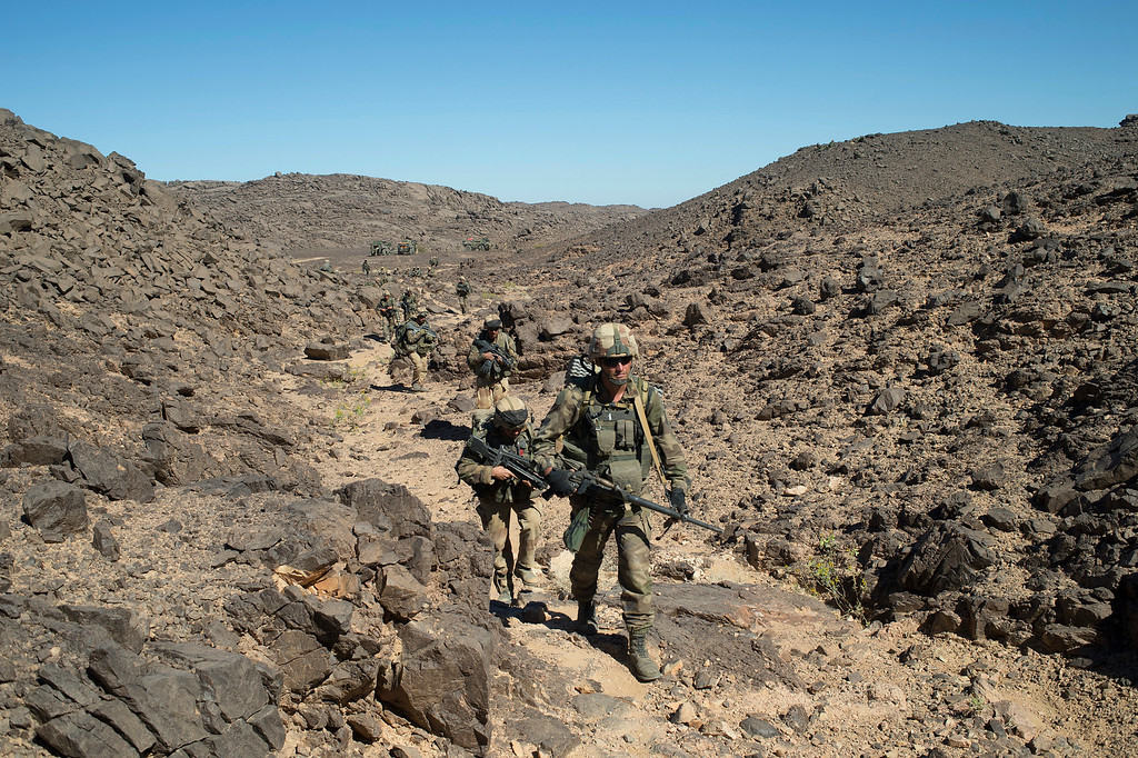 . This March 8, 2013 photo provided by the French Army Communications Audiovisual Office (ECPAD) shows French soldiers patrolling the Mettatai region in northern Mali. The Security Council unanimously approved a new U.N. peacekeeping force for Mali on Thursday, April 25, 2013 to help restore democracy and stabilize the northern half of the country which was controlled by Islamist jihadists until a France-led military operation ousted them three months ago. (AP Photo/ECPAD, Arnaud Roine)
