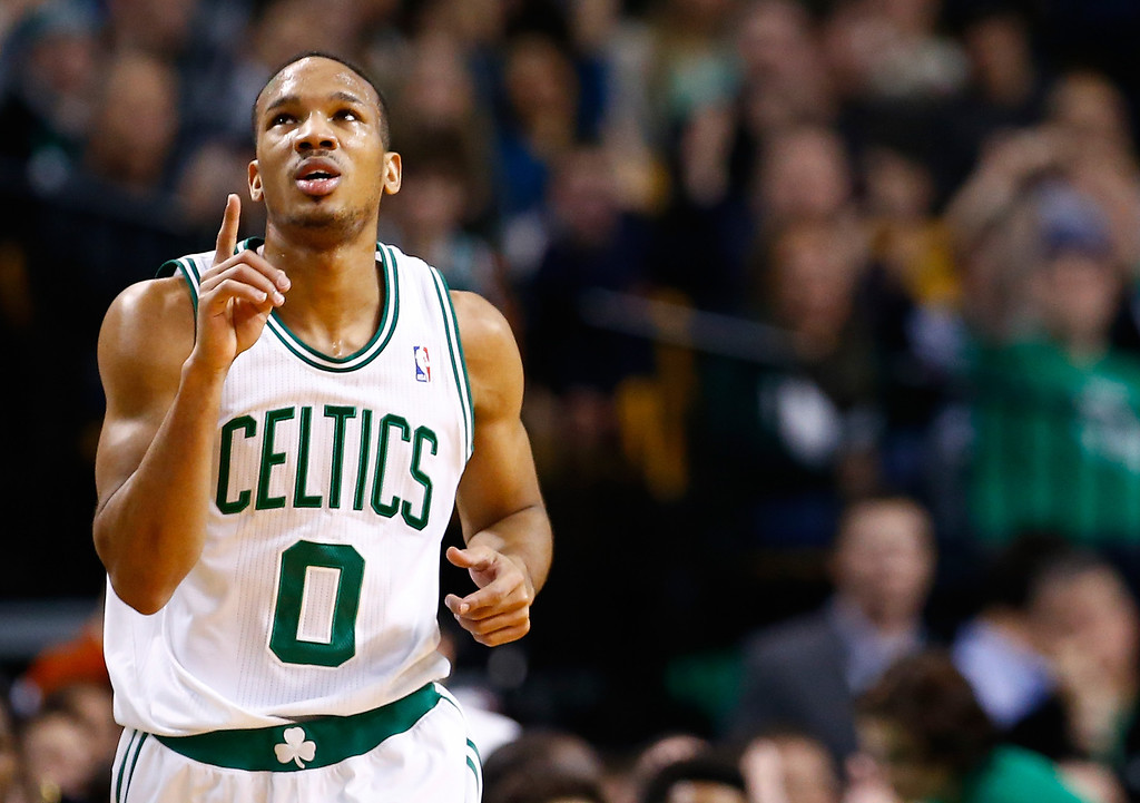 . BOSTON, MA - DECEMBER 06: Avery Bradley #0 of the Boston Celtics reacts following a three point shot in the second half against the Denver Nuggets during the game at TD Garden on December 6, 2013 in Boston, Massachusetts.  (Photo by Jared Wickerham/Getty Images)