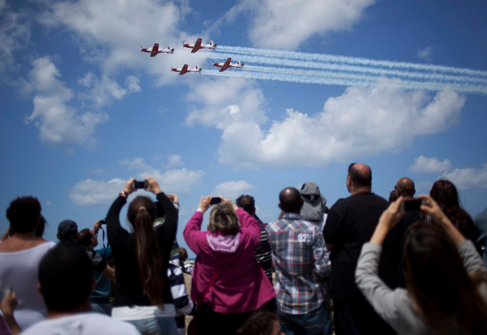 . People take a photographs during an Independence Day in Tel Aviv, Tuesday, April 16, 2013. Israel is celebrating its annual Independence Day, marking 65 years since the founding of the state in 1948. (AP Photo/Ariel Schalit)