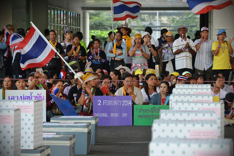 . Anti-government protesters gather in front of ballot boxes in preventing voting at a polling station in Thailand\'s general election on February 2, 2014 in Bangkok, Thailand. A number of polling stations were closed due to anti-government protesters disrupting proceedings. Despite election related violence and weeks of anti-government rallies in the run-up to the controversial snap-poll, voting passed without any major incident. Protest groups opposed to the government of caretaker Prime Minister Yingluck Shinawatra have called for political reform to take place before elections. (Photo by Rufus Cox/Getty Images)