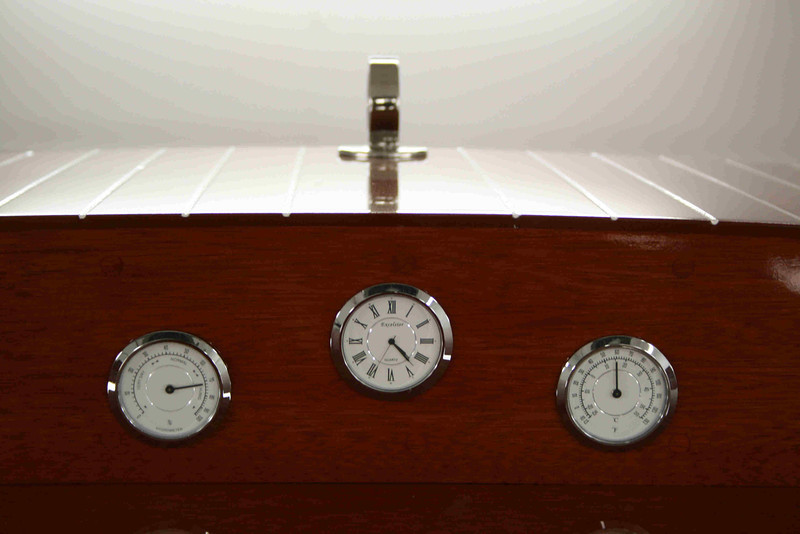 Instruments include clock, thermometer, and a barometer.