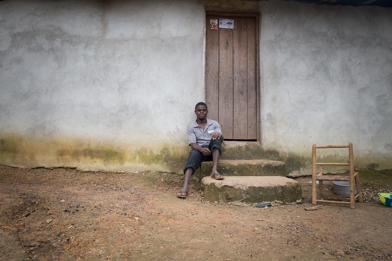 Monrovia, Liberia October 8, 2017 - Boimah Dorley sitting on a doorstep.