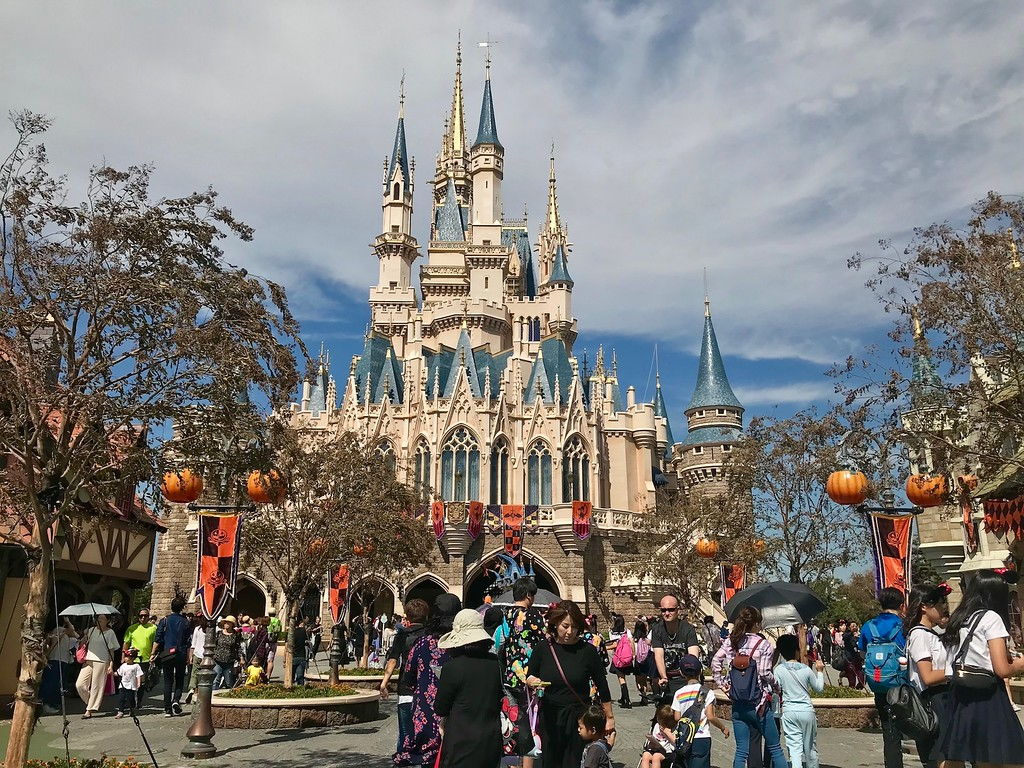 Cinderella's castle with Halloween decorations.