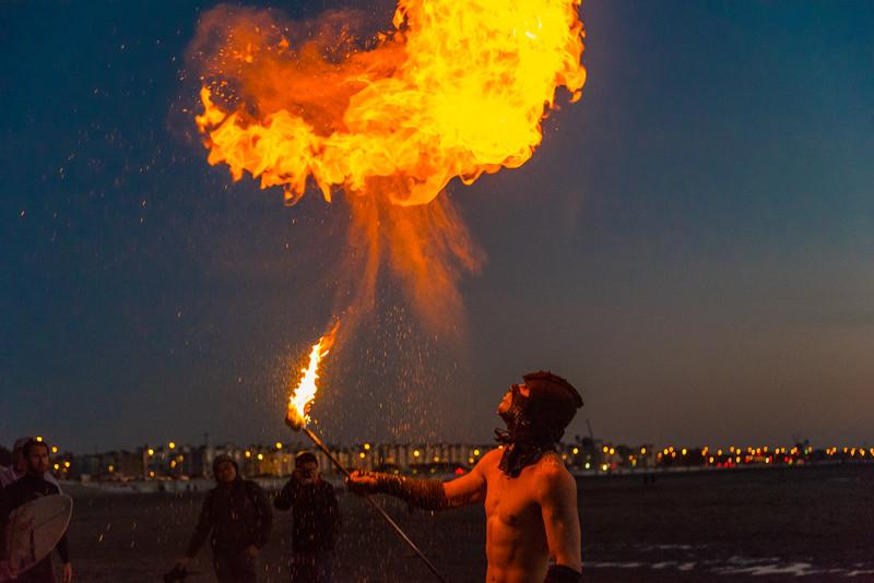 Man breathing fire on a beach in San Francisco