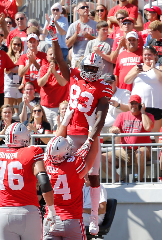 . Ohio State receiver Terry McLaurin, top, celebrates his touchdown against UNLV during the first half of an NCAA college football game Saturday, Sept. 23, 2017, in Columbus, Ohio. (AP Photo/Jay LaPrete)