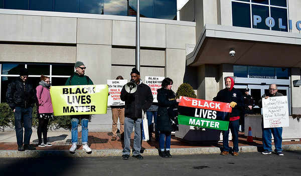 1/26/2019 Mike Orazzi | Staff Hartford community activist Cornell Lewis while leading a protest Saturday morning in downtown New Britain to protest the decision by an independent states attorney to not charge five police officers who fired on a carload of men, killing Zoe Dowdell and wounding two others last December.