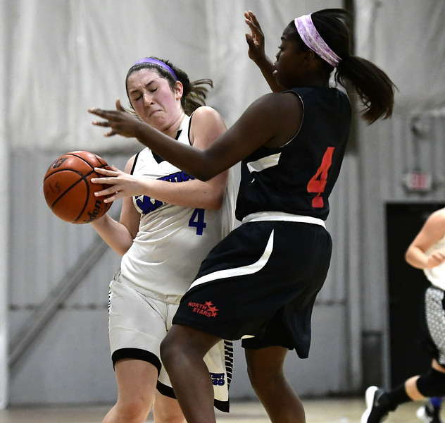 8/1/2018 Mike Orazzi | Staff Bristol Warriors' Skylar Blackington (4) and  CT Northstars' Janessa Pries (4) during Nutmeg State Games girls basketball at the Basketball House in Plainville Wednesday evening.