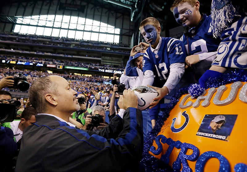 . Indianapolis Colts head coach Chuck Pagano autographs a football for a fan after the Colts defeated the Houston Texans, 28-16, in an NFL football game, Sunday, Dec. 30, 2012, in Indianapolis. Pagano has been suffering against a form of leukemia. This was his first game back after undergoing treatments. (AP Photo/Michael Conroy)