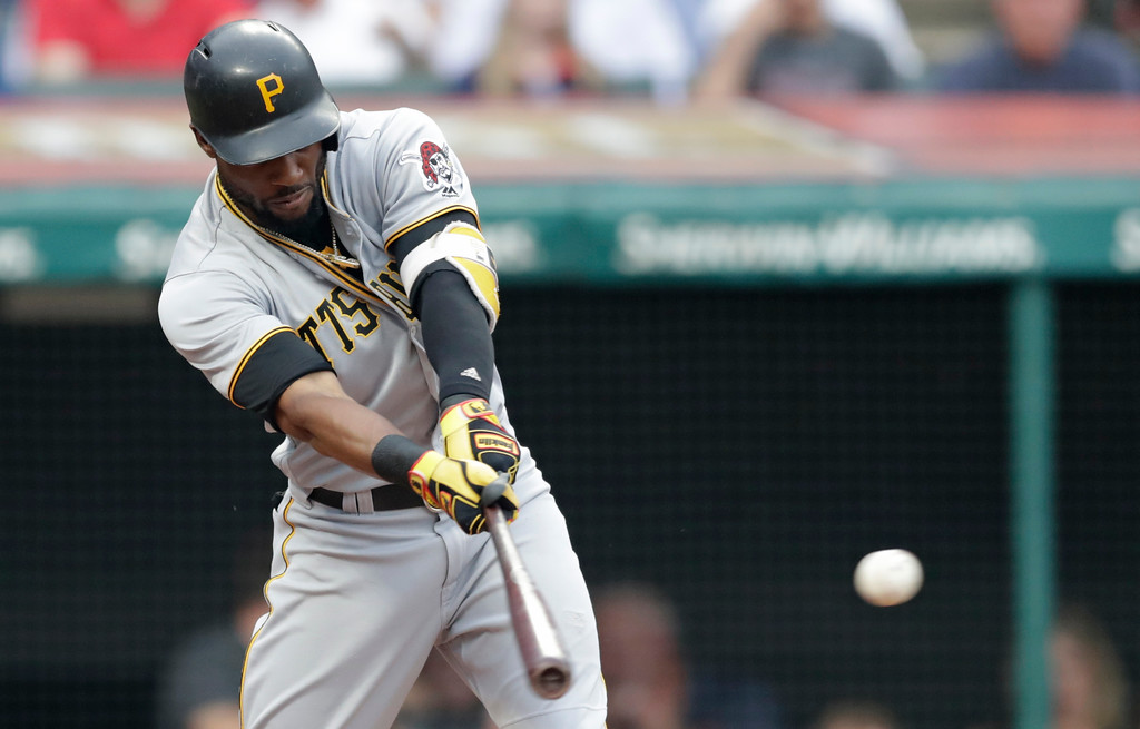 . Pittsburgh Pirates\' Starling Marte hits an RBI-single off Cleveland Indians starting pitcher Shane Bieber in the second inning of a baseball game, Tuesday, July 24, 2018, in Cleveland. (AP Photo/Tony Dejak)