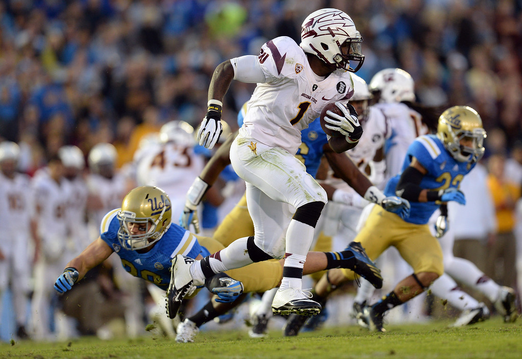 . Arizona State�s Marion Grice #1 looks for some running room during their game against UCLA at the Rose Bowl Saturday November 23, 2013. Arizona State beat UCLA 38-33. (Photos by Hans Gutknecht/Los Angeles Daily News)