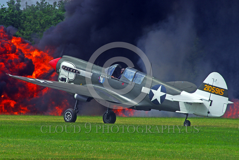 WB-Curtiss P-40 Warhawk 00007 A Curtiss P-40 Warhawk USA WWII era fighter taxis in front of a raging fire warbird picture by Stephen W. D. Wolf.JPG