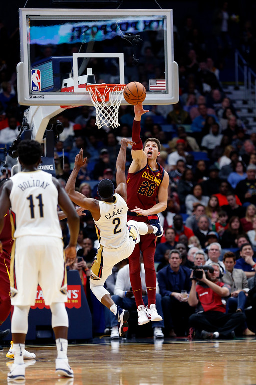 . Cleveland Cavaliers guard Kyle Korver (26) blocks a shot by New Orleans Pelicans guard Ian Clark (2) in the first half of an NBA basketball game in New Orleans, Saturday, Oct. 28, 2017. (AP Photo/Gerald Herbert)