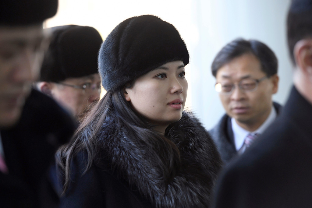 . Hyon Song Wol, center, leader of North Korea\'s Samjiyon Orchestra, arrives at the Inter-Korean Transit Office in Paju, near the Demilitarized zone dividing the two Koreas, Monday, Feb. 12, 2018 to leave for North Korea. The band held two performances at the Gangneung Art Center and National Theater of Korea. (Jung Yeon-je/Pool Photo via AP)