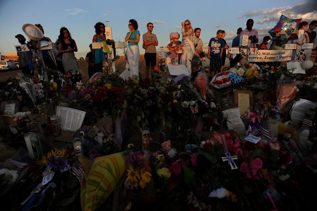 . Mourners and visitors continue to pay their respect at the site of the memorial on July 26th, 2012. The memorial is set up at South Sable Blvd and East Centrepoint Drive in Aurora to honor those who died in the shooting rampage. Helen H. Richardson, The Denver Post