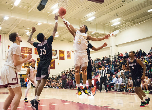 02/10/20 Wesley Bunnell | StaffrrNew Britain boys basketball lost at home to #1 Windsor on Monday night. Tyrone Cummings (3) fights for an offensive rebound.