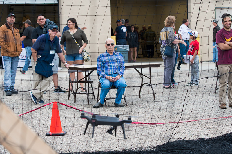 Guests spectate as a drone makes it's way through an obstacle course at the Lone Star UAS Drone Expo. Saturday March 04, 2017.
