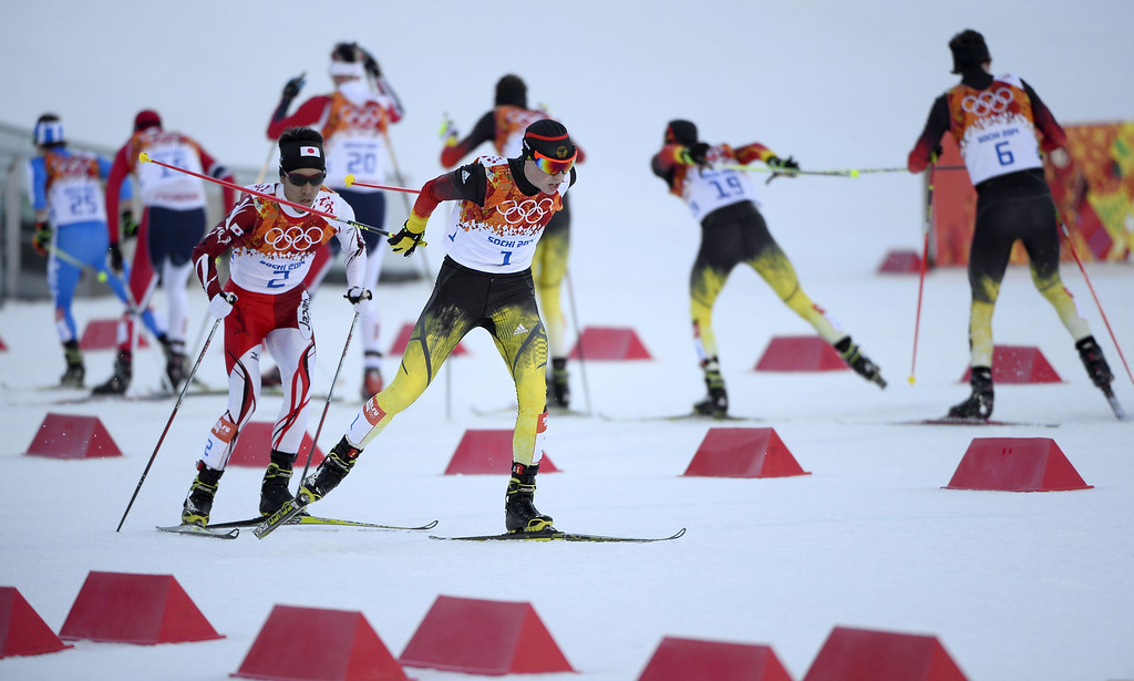 . Gold medalist Germany\'s Eric Frenzel (1) and silver medalist Japan\'s Akito Watabe (2) compete in the Nordic Combined Individual NH / 10 km Cross-Country at the RusSki Gorki Jumping Center during the Sochi Winter Olympics on February 12, 2014 in Rosa Khutor near Sochi. AFP PHOTO / PIERRE-PHILIPPE MARCOU/AFP/Getty Images