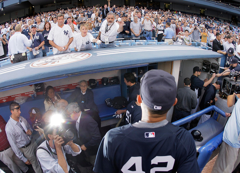 . Baseball fans plead for an autograph from New York Yankees\' Mariano Rivera (42) as he leaves the field after batting practice before a baseball game between the New York Yankees and the Baltimore Orioles on Sunday, Sept. 21, 2008, at Yankee Stadium in New York. (AP Photo/Julie Jacobson)