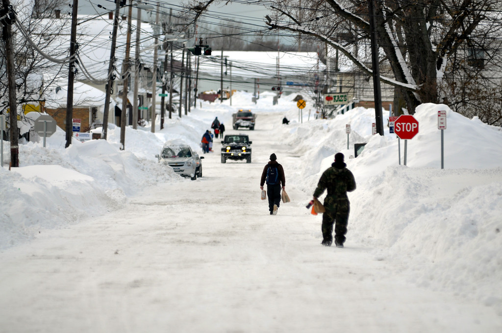 . Residents take to the street for supplies along Lake Avenue on November 20, 2014 in the suburb of Blasdell, Buffalo, New York.  (Photo by John Normile/Getty Images)