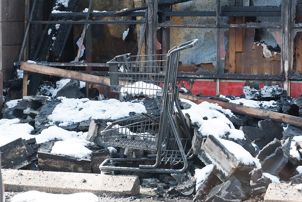 03/04/19 Wesley Bunnell | Staff Fire destroyed Tops Marketplace located at 887 Meriden-Waterbury Tpke in Southington on Monday night. A shopping carriage stands in front of a burned out wall.