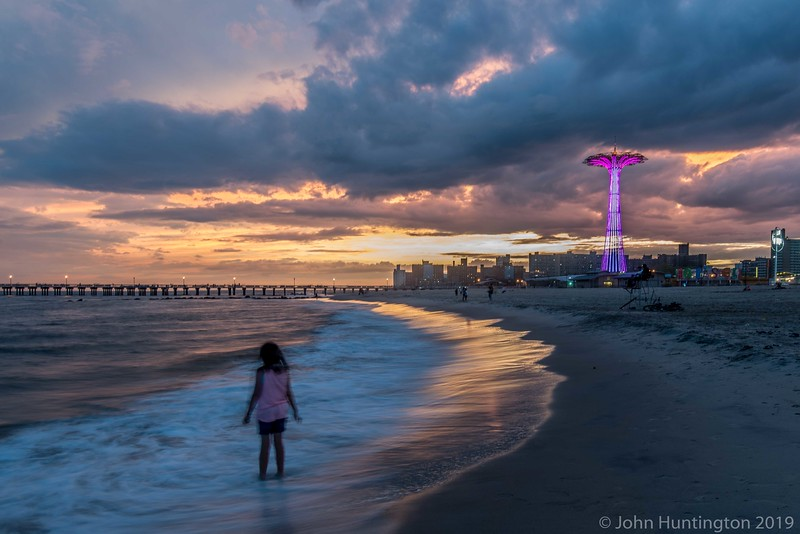 A dramatic sunset over Coney Island.