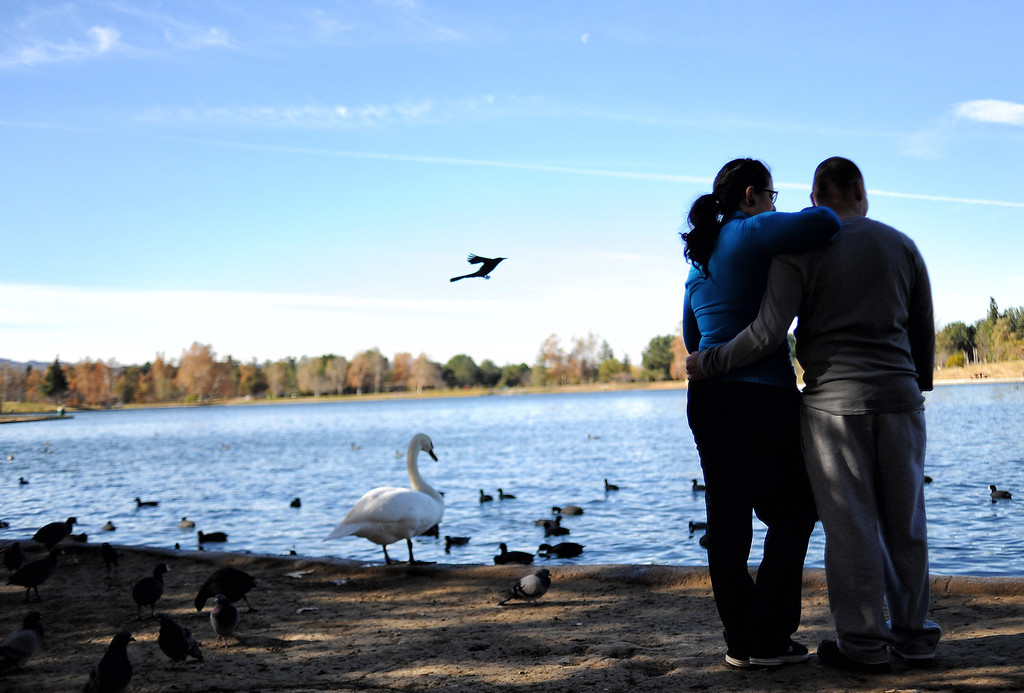 . Gabby Sandoval and Abl Pulido watch birds while enjoying the warm weather at Lake Balboa in Anthony C. Beilenson Park in Van Nuys on Christmas day. (Photo by Hans Gutknecht/Los Angeles Daily News)