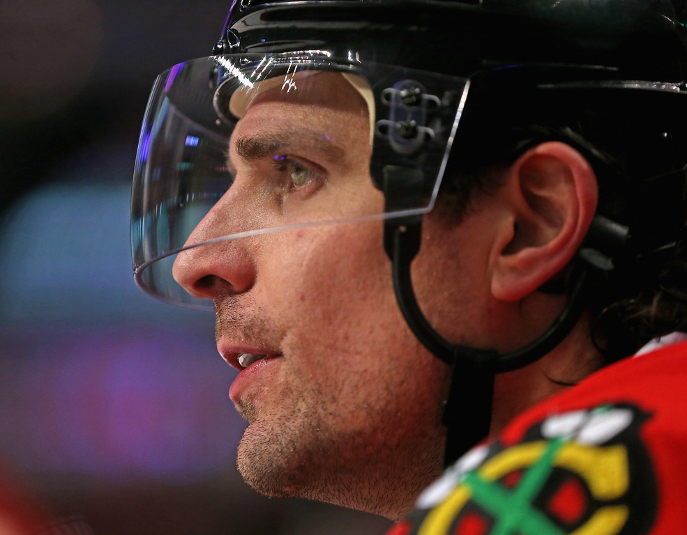 . CHICAGO, IL - DECEMBER 27: Patrick Sharp #10 of the Chicago Blackhawks, who scored three goal through two periods on his birthday, watches teammates from the bench as they take on the Colorado Avalanche at the United Center on December 27, 2013 in Chicago, Illinois. (Photo by Jonathan Daniel/Getty Images)