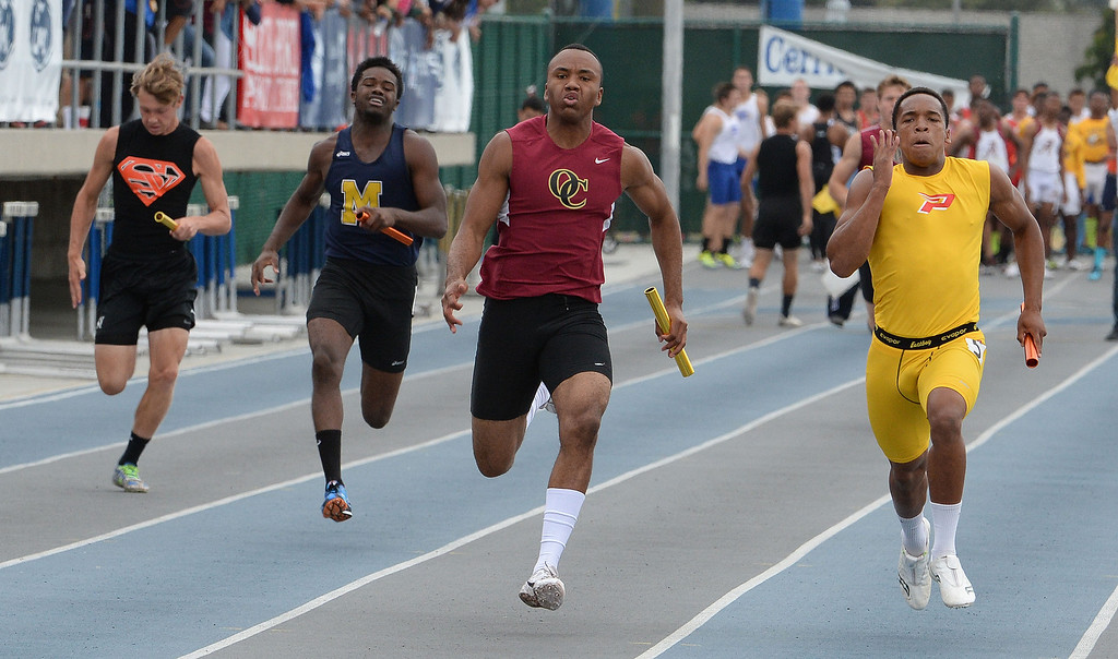 . Paraclete\'s Triston Brown, right, along with Oaks Christian\'s Jordan Anderson runs the final leg of the division 4 4x100 meter race as Paraclete won the race during the CIF Southern Section track and final Championships at Cerritos College in Norwalk, Calif., Saturday, May 24, 2014.   (Keith Birmingham/Pasadena Star-News)