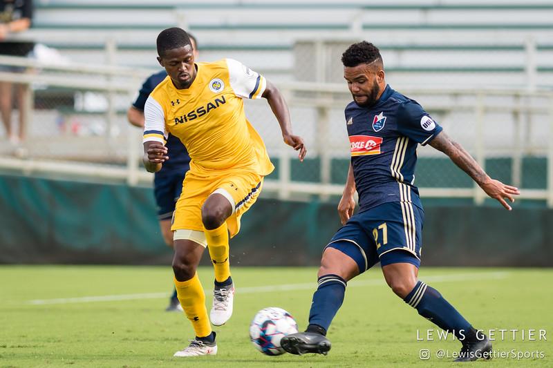 Nashville SC midfielder Lebo Moloto (10) and North Carolina FC defender D.J. Taylor (27)