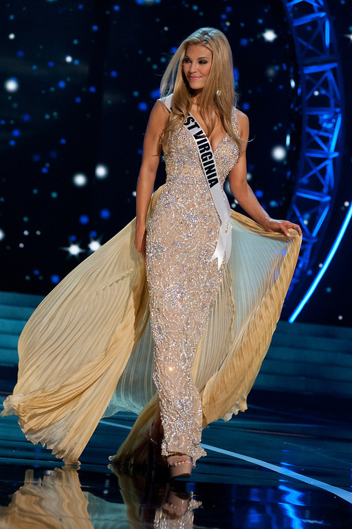 . This photo provided by the Miss Universe Organization, Miss West Virginia USA 2013, Chelsea Welch competes in her evening gown during the 2013 Miss USA Competition Preliminary Show  in Las Vegas  on Wednesday June 12, 2013.  She will compete for the title of Miss USA 2013 and the coveted Miss USA Diamond Nexus Crown on June 16, 2013.  (AP Photo/Miss Universe Organization, Patrick Prather)