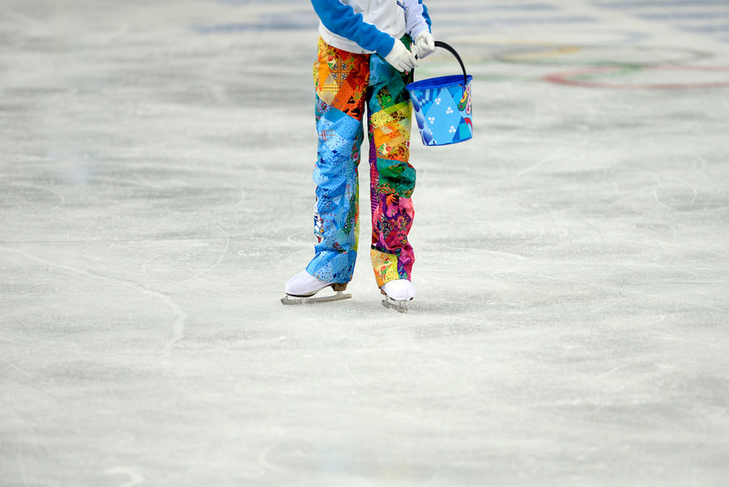. Volunteers repair the ice during team figure skating. Sochi 2014 Winter Olympics on Saturday, February 8, 2014. (Photo by AAron Ontiveroz/The Denver Post)
