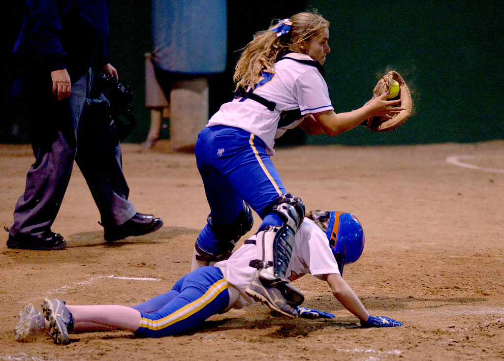 . 05-03-2013-(LANG Staff Photo by Sean Hiller)-  El Segundo\'s Rhianna Rich is safe at home plate as Agoura\'s Liv Gunther waits for the ball in the El Segundo Softball Tournament final Saturday night at Recreation Field in El Segundo.