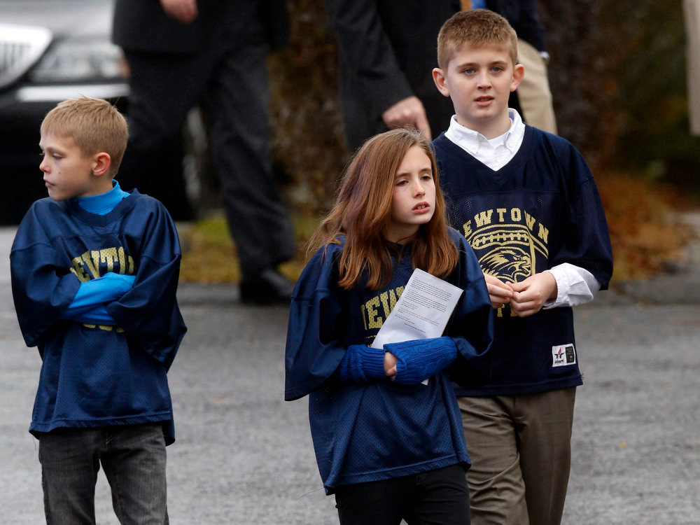 Description of . Schoolchildren leave Honan Funeral Home in Newtown, Connecticut, December 17, 2012, after attending a funeral service for six-year-old Jack Pinto, one of 20 schoolchildren killed in the December 14 shootings at Sandy Hook Elementary School in Newtown. REUTERS/Mike Segar