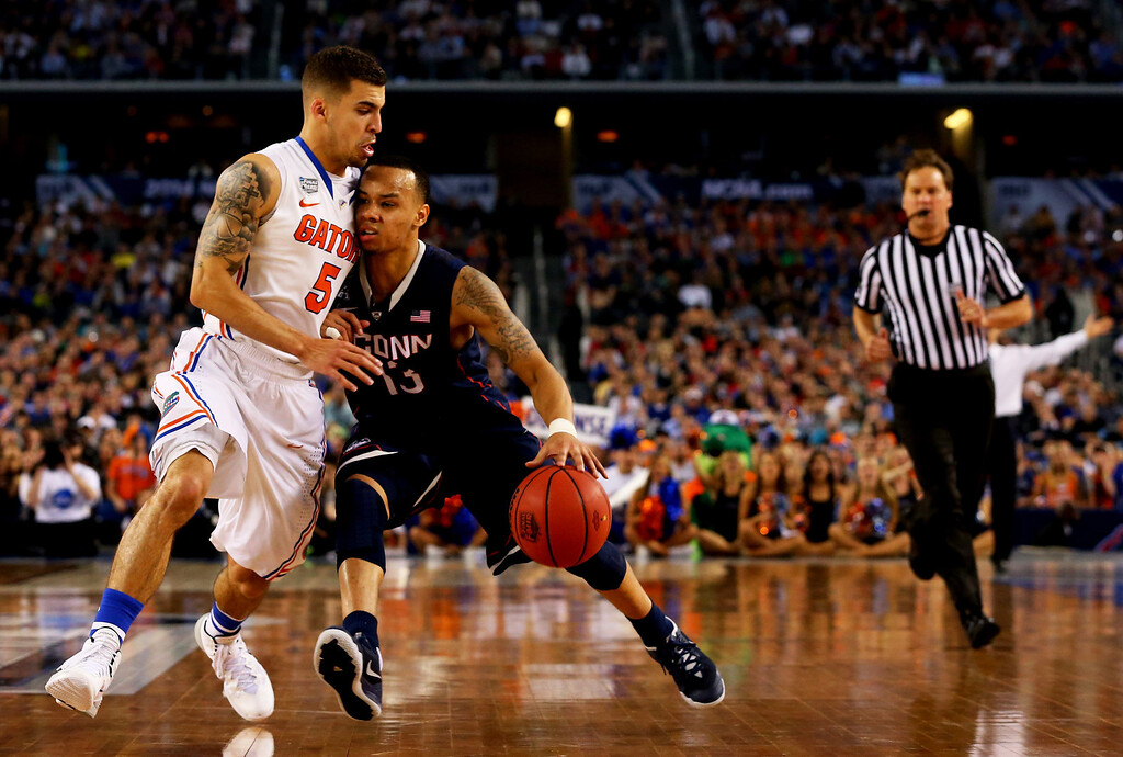 . ARLINGTON, TX - APRIL 05: Shabazz Napier #13 of the Connecticut Huskies drives to the basket as Scottie Wilbekin #5 of the Florida Gators defends during the NCAA Men\'s Final Four Semifinal at AT&T Stadium on April 5, 2014 in Arlington, Texas.  (Photo by Ronald Martinez/Getty Images)
