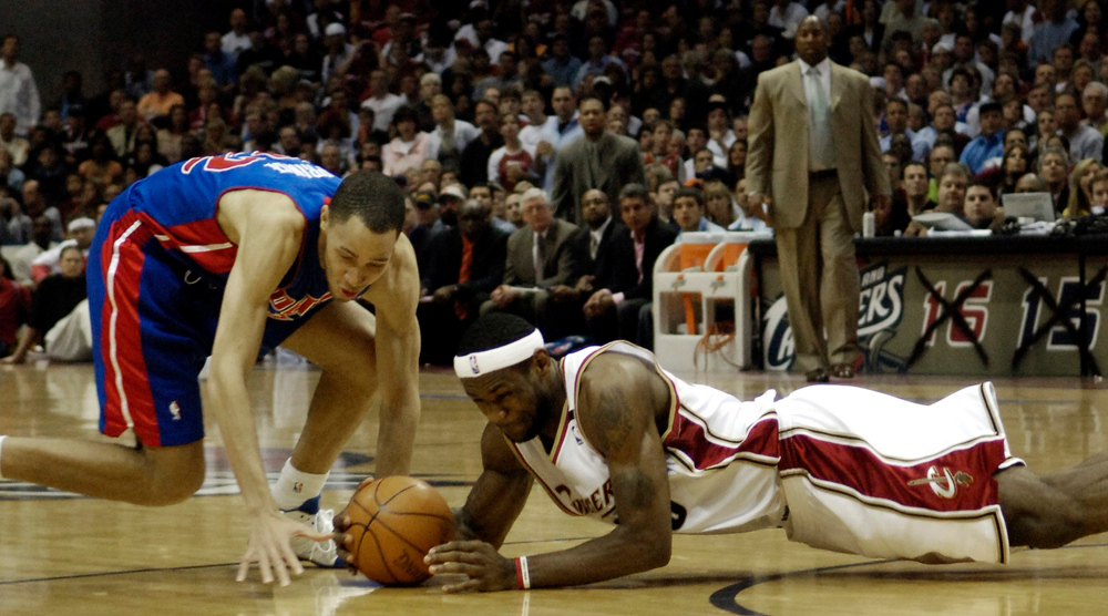 . Ken Blaze/KBlaze@News-Herald.com LeBron James and Detroit\'s Tayshaun Prince fight for a loose ball Friday at the Q.
