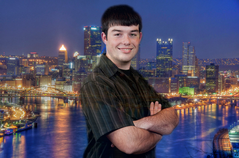 Zack with Pittsburgh at night in the background