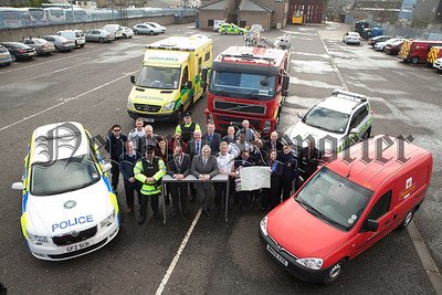 Environment Minister Danny Kennedy and Mayor Mickey Ruane are pictured with members of eth PSNI, Fire Service, Ambulance Service and Roay Mail at a photocall to address unnamed roads in the district. R1410004