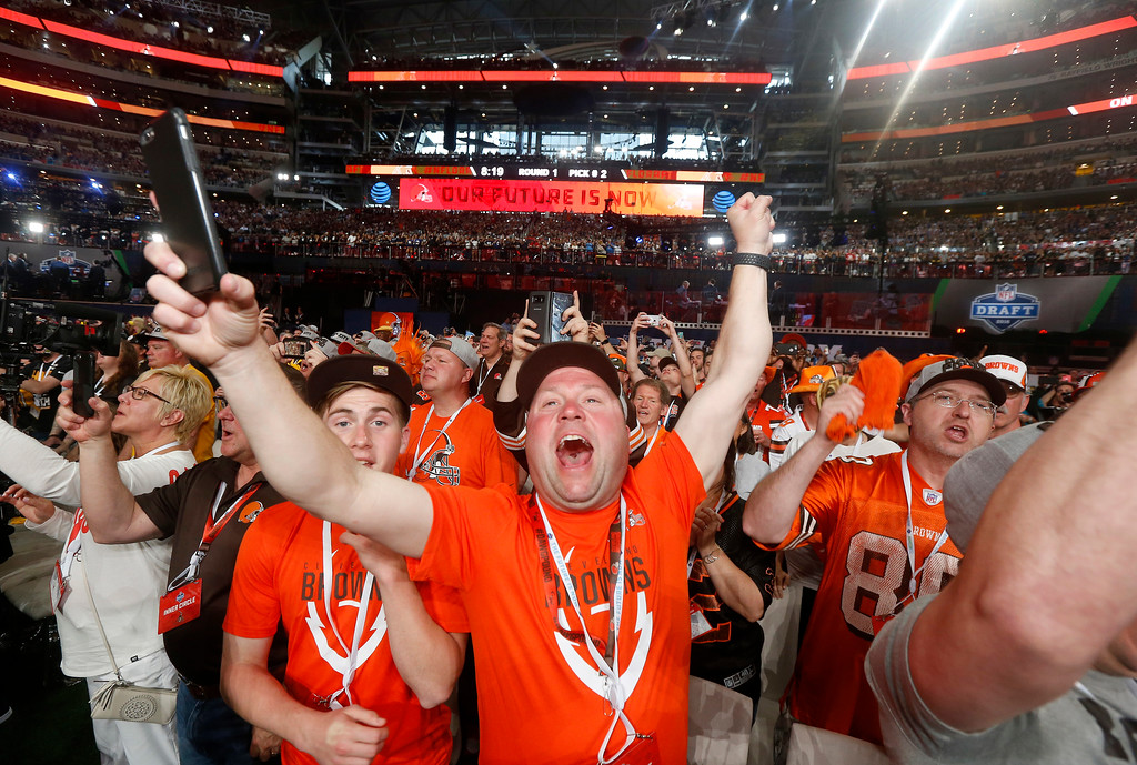 . Cleveland Browns fans react to Ohio State\'s Denzel Ward being selected by their team during the first round of the NFL football draft, Thursday, April 26, 2018, in Arlington, Texas. (AP Photo/Michael Ainsworth)