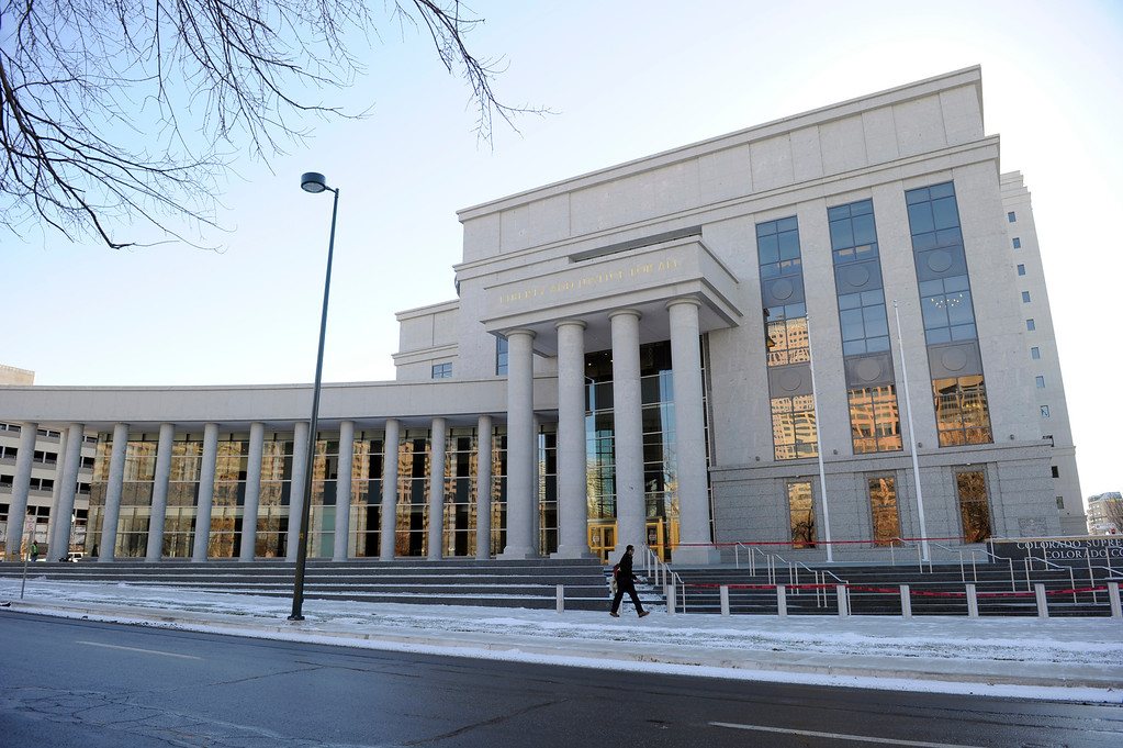 . Construction crews put the finishing touches on the new Ralph L. Carr Colorado Judicial Center at 2 East 14th Avenue in Denver on Tuesday, Dec. 11, 2012. The courts will officially open at this location at 8 a.m. on Wed. Dec. 19, 2012. Kathryn Scott Osler, The Denver Post