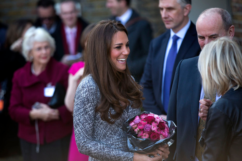 Description of . Britain's Kate, The Duchess of Cambridge receives a bouquet of flowers, as she leaves after a visit to Hope House, in London, Tuesday, Feb. 19, 2013. As patron of Action on Addiction, the Duchess was visiting Hope House, a safe, secure place for women to recover from substance dependence.  (AP Photo/Matt Dunham)