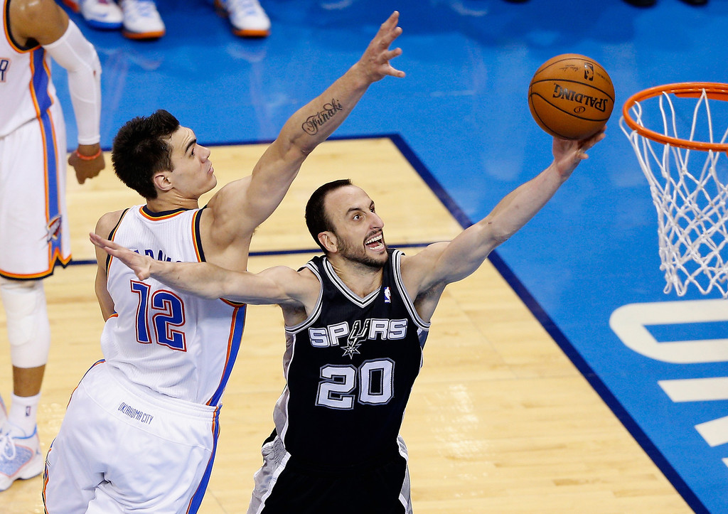 . OKLAHOMA CITY, OK - MAY 25: Manu Ginobili #20 of the San Antonio Spurs drives to the basket against Steven Adams #12 of the Oklahoma City Thunder in the first half during Game Three of the Western Conference Finals of the 2014 NBA Playoffs at Chesapeake Energy Arena on May 25, 2014 in Oklahoma City, Oklahoma.  (Photo by Joe Robbins/Getty Images)