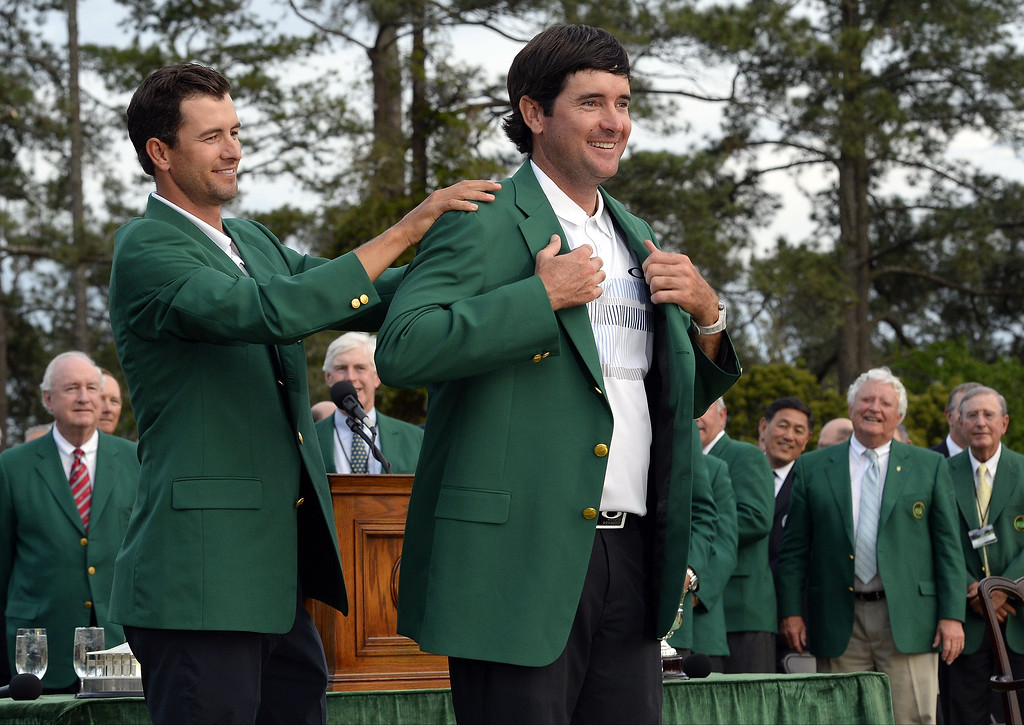 . Adam Scott (L) of Australia presents Bubba Watson of the US the Masters winner\'s green jacket during a ceremony at the end of the 78th Masters Golf Tournament at Augusta National Golf Club on April 13, 2014 in Augusta, Georgia. Watson won his second Masters finishing 8-under par.    TIMOTHY A. CLARY/AFP/Getty Images
