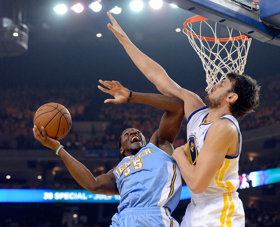 . OAKLAND, CA. - APRIL 26: Kenneth Faried (35) of the Denver Nuggets goes up for a shot on Andrew Bogut (12) of the Golden State Warriors during the first quarter in game 3 of the first round of the NBA Playoffs April 26, 2013 at Oracle Arena.  (Photo By John Leyba/The Denver Post)