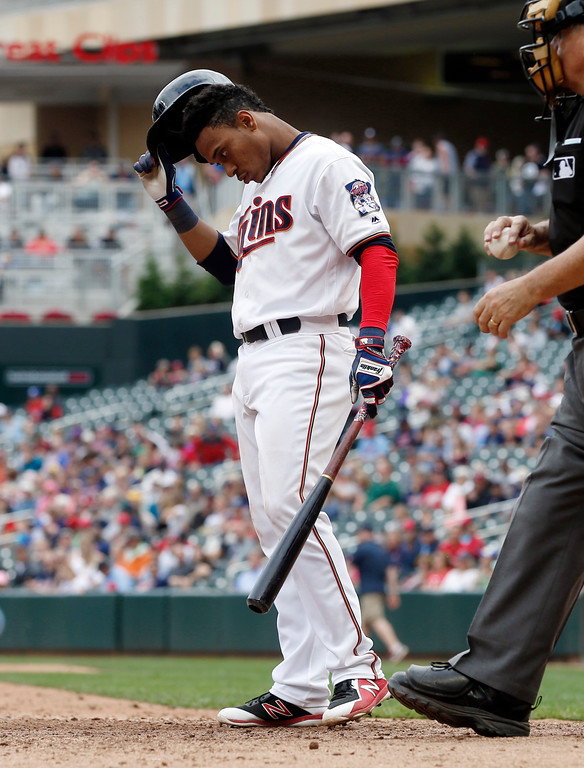 . Minnesota Twins\' Jorge Polanco pauses at the plate after he was called out looking in the eighth inning of the first baseball game of a doubleheader against the Cleveland Indians, Thursday, Aug. 17, 2017, in Minneapolis. The Indians won 9-3. (AP Photo/Jim Mone)