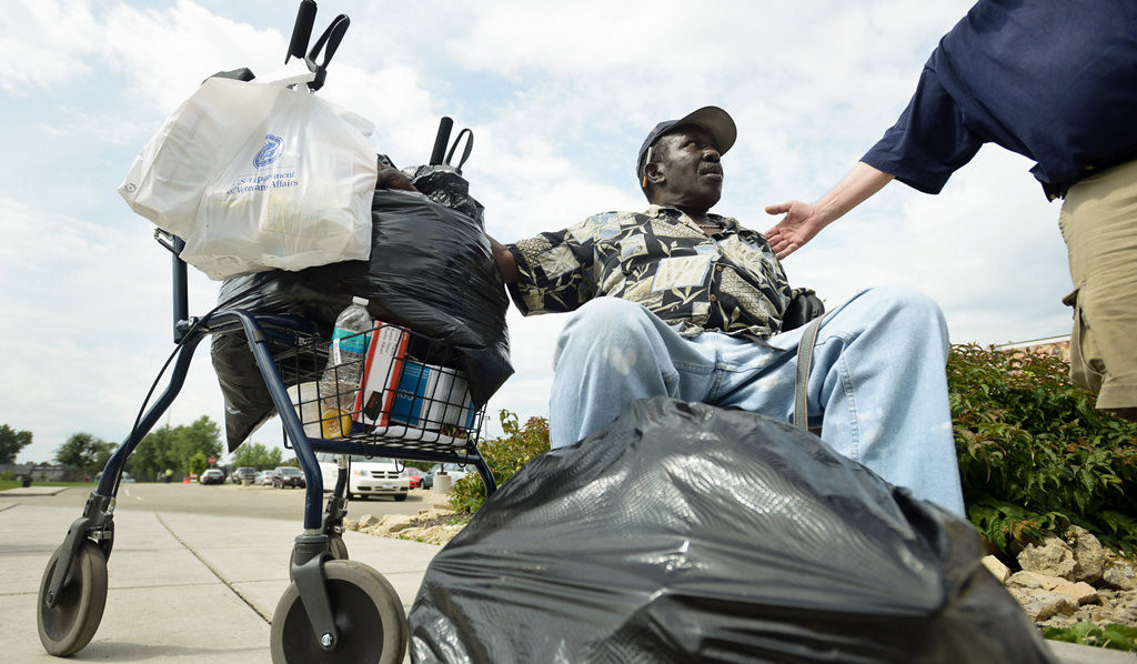 """. Veteran Cager Banks, 70, of Minneapolis waits for a lift. Banks, who is homeless, served in the Navy during the Vietnam War from 1960 to 1964. \""""Veterans risk their life for their country so your country can at least try and help you out when you\'re beat up and broke up and banged up,\"""" Banks said. (Pioneer Press: Ben Garvin)"""