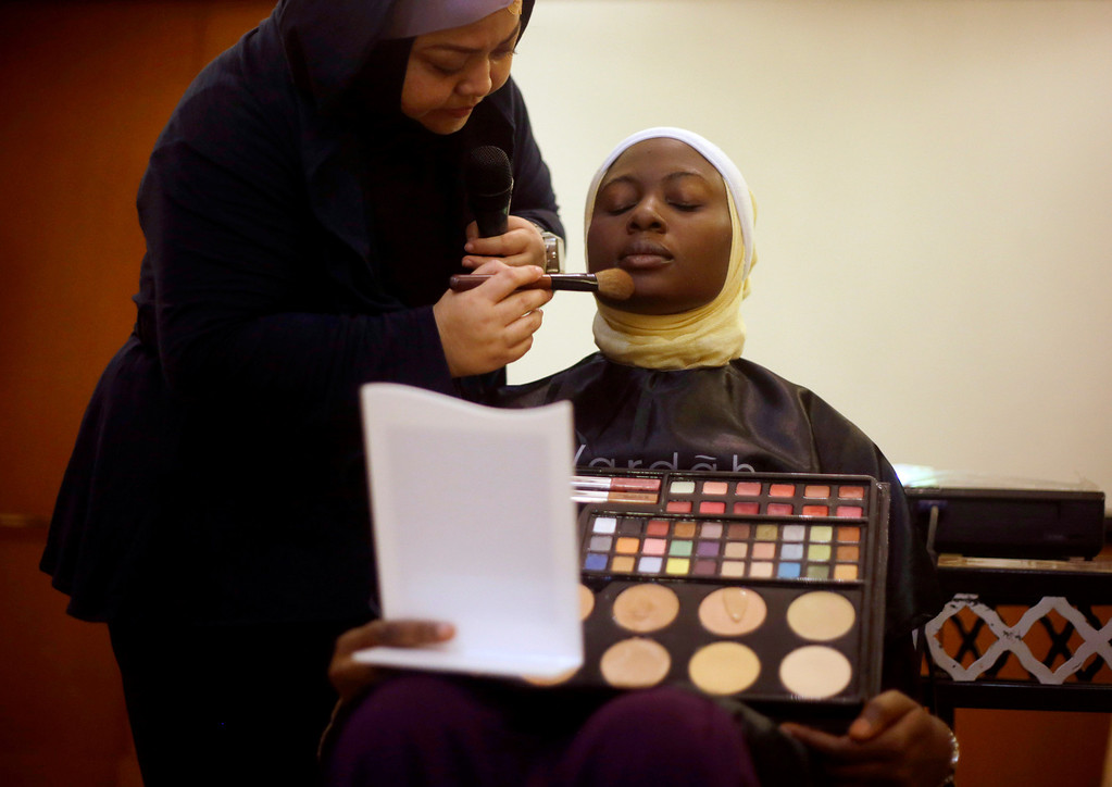 . In this Monday, Sept. 16, 2013 photo, Obabiyi Aishah Ajibola of Nigeria has her make up applied during a beauty class part of the 3rd Annual Award of World Muslimah, a competition billed as the Islamic alternative to Miss World pageant, in Jakarta, Indonesia.  (AP Photo/Dita Alangkara)